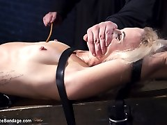 Dylan is restrained in wooden stocks around her neck and wrists. Her ankles are locked down in steel pipes. Her clothes ripped away and her body is exposed to the brutal thrashing that reddens her fragile skin. Next she is spread out on our Y table with her pussy exposed and with out any chance of escaping. The cane is precise and painful when it strikes her. She screams to release the weakness from her body, but that doesn't make it stop.In the final scene the suffering continues, and then a full pussy assault. Every possible implement possible is used to terrorize her worn out cunt.