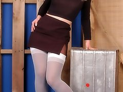 Bombshell in white stockings over black pantyhose