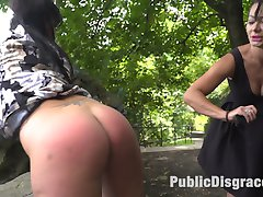 Naomi is a brand new pain slut from Budapest who has never been naked in public before.  Steve Holmes, Sandra Romain, and Ram bring Naomi to Gellert Hill to be face fucked and flogged on a woodsy bike trail while passerbys cant help but stare. Later, Naomi tries hard to cover her tits and pussy after having her clothes cut off, walking through the busy city and at  a nearby bar, Steve and Ram fuck Naomi deep and hard while all the patrons take turns using whips and paddles.
