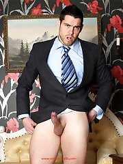 Horny stud Dean is wearing a suit and masturbating hard
