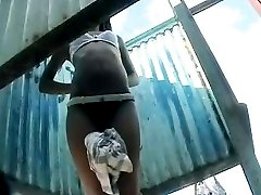 Pretty chicks captured on hidden cam change tight clothes for bathing suits