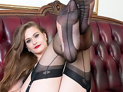 Honour has kitted herself out in a rare vintage corselette, sheer black vintage nylons and her flashy designer heels!