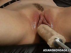 Magnificent blond bitch dominates the slut with a fuck machin