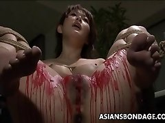 Chinese babe get her privates frosted in wax.
