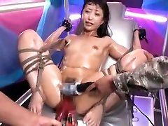 Tied Asian cockslut gets stimulated by toys to orgasm