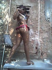 Black chick wears skimpy lingerie outdoors