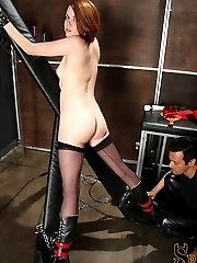 Lilla Katt is chained up as Sir Nik Satanas paddles her ass, really hard. He flogs her, then forces her to cum from a vibrator. Lilla Katt does so well in her bondage scene, a true bit of aftercare is shown at the very end.