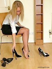 This blonde just cannot wait to get down to her lingerie and high heels
