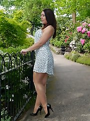 Dark-haired babe Lauryn taunting in the park in a pair of entirely fashioned nylons and black stilettos