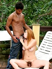 Dirty lady Tais goes down to suck a cock and later rides it with her hairy pussy in the outdoors
