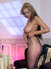 Bigtitted nude beauty puts on and ladders her new black fashion pantyhose
