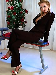 Red hot business lady dildo toys in her seamed hose before getting dressed