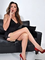 Nylon Jane clothed in undergarments and silky nylons strings up her high heel shoes and smokes in her fetish