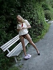 Hot blonde outdoor stockings tease