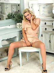 Vanessa strips off her full skirted dress to pose explicitly in extreme heels, French lacy girdle and vintage fully fashioned nylons!