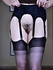 Dressed like a punk chick slurps her black stockings and demonstrates her bush