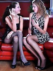Two lez gals show off their slim pantyhosed legs before mutual slit lapping
