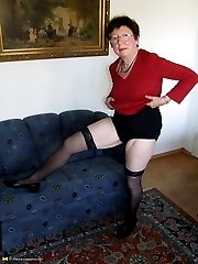 Kinky housewife playing with beads on her couch