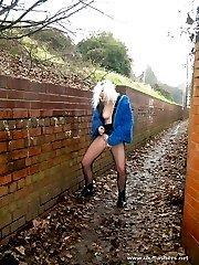 Young blonde chick masturbating in an alley