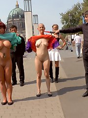 Hot Busty MILF Jolyne Joy and Made Kate are two of Berlin's freakiest and they have no idea what they've signed up for on Public Disgrace. Mona Wales humiliates them like dogs having them drink out of bowls while getting their assess slapped red and then crawl around the dirty streets on their hands and knees. These fully exposed women have to interact with huge crowds and shamed in front of all to see. Only Mad Kate was able to make it to the trash heap where she gets epically fucked and humiliated in front of a huge rowdy crowd. She is tied up in rope bondage and gets spit on and fucked and slapped til she screams so loud! This bald lesbian just wants to see pussy so she can cum, but has to service all the cocks first in every one of her holes. Double Penetration, Double Anal, Double Vaginal, Mad Kate takes it all! That hungry hungry asshole is stuffed full of stranger cock! When she finally cums she screams soo loud and makes the ugliest humiliating cum face ever on Public Disgrace!