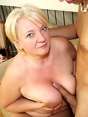 Gigantic mature slut taking the young dude's cock after he helps with her grocery bags