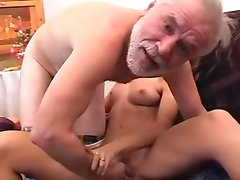 Young redhead rides mature dick