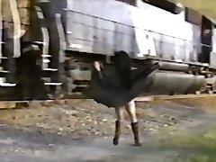 Asian damsel in trench coat flashes train