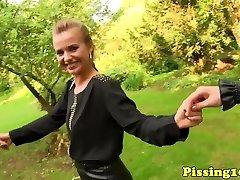 Peeing euros outdoors having lesbian fun