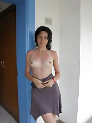 Naughty Korean babe flashes breasts and pussy