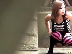 Asian slut urinate squats