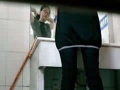 Toilet voyeur video of Asian lady peeing in restaurant