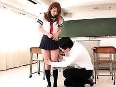 Asian schoolgirl facialized in classroom