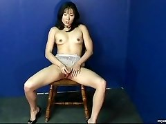 Fantastic Asian honey rubbing on her wet cooch