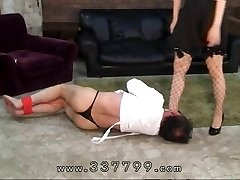 Japanese femdom gimps penis in hot paraffin wax.