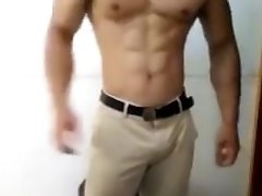 Hot muscle guy flex and grab his bulge