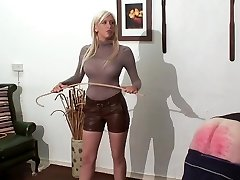 caning punishment by hot young light-haired domme in leather sh