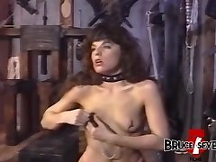 Girly-girl femdom playing with her held submissive