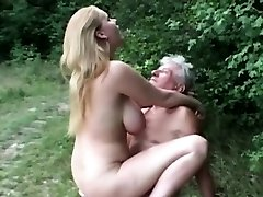 Natural huge titted slut fucks grandpa in the woods