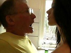 Daring young brunette fucks rigid grandpa in the kitchen