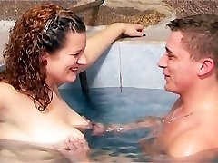 Pool water hoists and hardens her nipples