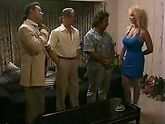 Busty blonde takes on two dicks and gets a double penetration