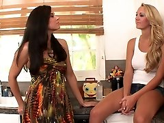 Kinky brunette rubs hot blonde's labia with her foot