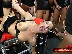 Dirty brunette mega-bitch used as a toilet in a huge gangbang