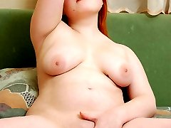 Full kitty spreads the lips of her tight snatch