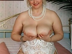 BBW in white lingerie toying with her tits