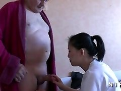 Youthfull nurse blows an old man