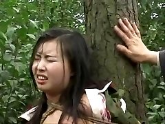 Chinese army girl trussed to tree 2