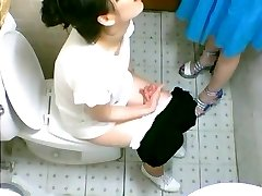 Two cute Asian girls eyed on a toilet cam pissing