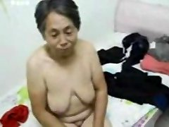 Asian Grandma get dressed after romp