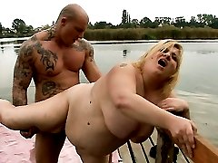 Blonde BBW Amanda gets her pussy drilled hard by a tattooed hunk outdoors